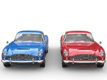 Red and blue vintage cars - studio shot - front view Stock Photos