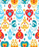 Red blue and white colorful ikat asian traditional fabric seamless pattern, vector Stock Photos