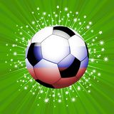 Football soccer ball in red blue and white on star burst Royalty Free Stock Photo