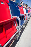 Red, blue and white grandstand seats. Super speedway grandstand seats close up in red, blue and white stock photography