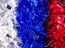 Red, blue and white new year tinsel decoration background stock images