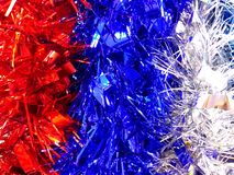 Red, blue and white new year tinsel decoration background royalty free stock photo
