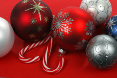 Red, blue, white and silver christmas balls and tw Royalty Free Stock Images