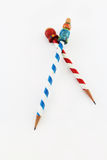 Red blue and white spiral stripe vintage pencils. Crossed red blue and white spiral stripe vintage school pencils isolated on white Royalty Free Stock Image