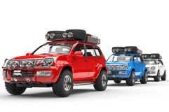 Red, Blue and White SUVs Royalty Free Stock Photos