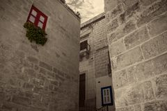 Red and Blue Windows. Within the historic old city of Cospicua, Malta stock photography