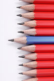 Red and blue wooden crayons Royalty Free Stock Images