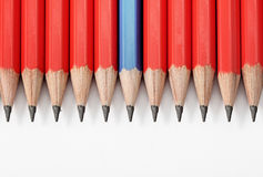 Red and blue wooden crayons in line Stock Photos