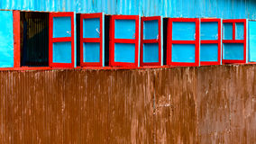 Red and blue wooden windows Stock Photography