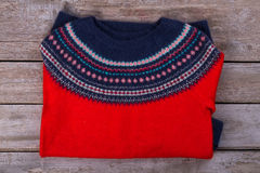 Red and blue woolen sweater with a beautiful ornament. Royalty Free Stock Photo