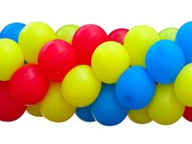 Red, blue and yellow celebration balloons in stack isolated Royalty Free Stock Images