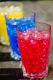 Red blue and yellow cocktails. Row red, white and blue cocktails with ice royalty free stock photos