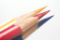 Red Blue Yellow Colored Pencils. Sharp red blue and yellow colored pencil on white Royalty Free Stock Images