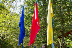 Red, blue and yellow flags. Royalty Free Stock Images