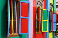 Red, Blue, Yellow, Green, Purple, All the colors. Colorful windows and detail on a colonial house in Singapore. The picture is full of color stock image