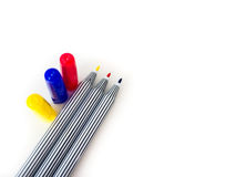 Red, blue, yellow magic pen on white background Stock Photography