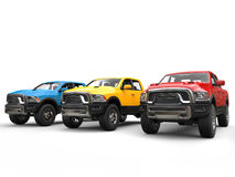 Red, blue and yellow modern pick-up trucks - studio shot Stock Photography
