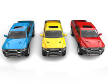 Red, blue and yellow modern pick-up trucks - top down front view Stock Photos