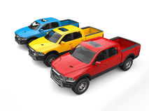 Red, blue and yellow modern pick-up trucks - top down view Stock Photos