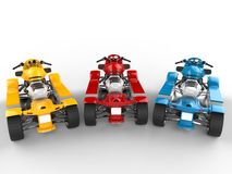 Red, blue and yellow modern quad bikes Royalty Free Stock Photo