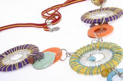 Geometric and colorful necklace. Red, blue, yellow, orange, light blue are some of the colors of this amazing and geometric necklace with a lot of circules stock photos