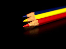 Red, blue, yellow pencils. Primary colors, red, blue, and yellow, colored pencils on a black background Stock Images