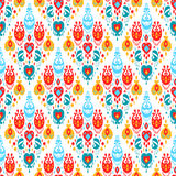 Red blue yellow and white colorful ikat asian traditional fabric seamless pattern, vector Royalty Free Stock Photo