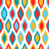 Red blue yellow and white colorful ikat asian traditional fabric seamless pattern, vector. Background Stock Illustration