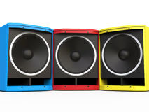 Red, Blue and Yellow woofer speakers Royalty Free Stock Image