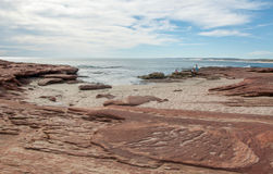 Red Bluff Beach: Coastal Sandstone. Inlet with the sandstone rock formations at Red Bluff beach with the Indian Ocean seascape under a blue sky with clouds on Royalty Free Stock Photography