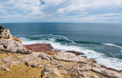 Red Bluff: Cliff Views. Cliff views from the Red Bluff lookout of the turquoise Indian Ocean seascape, red sandstone rock, and foamy waves under an overcast sky Stock Photos