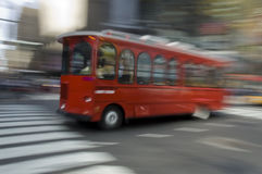 Red Blur. Blur of a New York sightseeing bus speeding down the street Stock Images