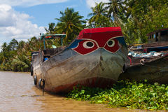 Red Blye Painted Eyes Boats on Vietnam Mekong Delta Village clo royalty free stock photos