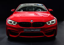 A red BMW M4 car. In black background Stock Image