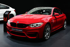 A red BMW M4 car. In black background Royalty Free Stock Photography