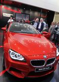 Red BMW M6 coupe. GENEVA - MARCH 16 : Red BMW M6 coupe on display at the 82st International Motor Show Palexpo -Geneva on March 16; 2012 in Geneva, Switzerland Royalty Free Stock Photo