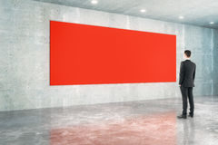 Red board and businessman. In concrete interior design. Mock up, 3D Rendering Stock Photo