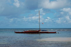Red Boat. Off the coast of Kauai, Hawaii (USA Stock Photography