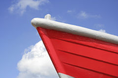 Red boat. Front of a bright red boat against a lovely blue sky, landscape format Stock Images