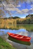 Red boat. In riverside landscape, Cavado river, Portugal (HDR photo stock photos