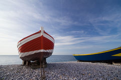 Red boat. On shingle in Etretat, Normandy, France stock image