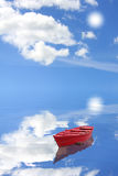 Red boat. And cloudy blue sky stock photography