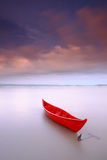 Red boat anchored durimg sunset Royalty Free Stock Photography