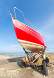 Red boat anchored at stone pier Royalty Free Stock Photo