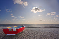 Red boat on beach. At dunwich, suffolk royalty free stock photography