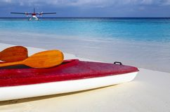 Red boat is on a beach 2. Paddle red boat is on a sandy beach royalty free stock photography
