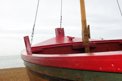 Red boat on the beach. With close up shot royalty free stock photos