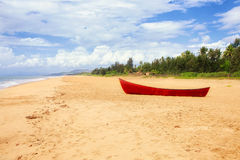 Red boat on beach Stock Image