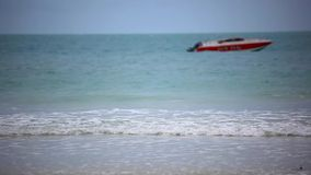 Red boat on a beach. Sea waves during cloudy. Weather. 1920x1080 stock footage