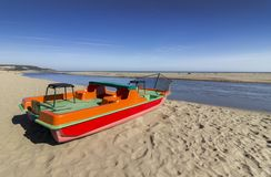 A red boat on the beach. A red boat on the shore of the Kamchia River on the Black Sea royalty free stock images